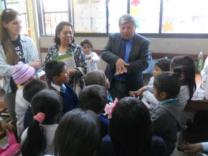 Principal Freddy and his students demonstrate proper hand-washing techniques.